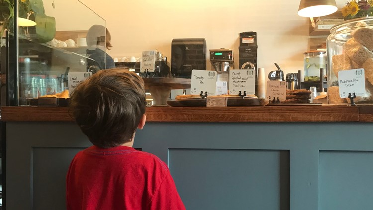 Boy tried to pick out his cookie at 1748 Bakehouse in Springfield