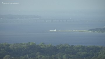 Plane skids into St. Johns River after landing on NAS Jax airport runway