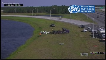 Car in pond after crash on State Road 9B near Old St. Augustine Road