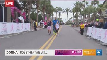 Tim and Donna Deegan cross the finish line of the 2019 Donna Marathon