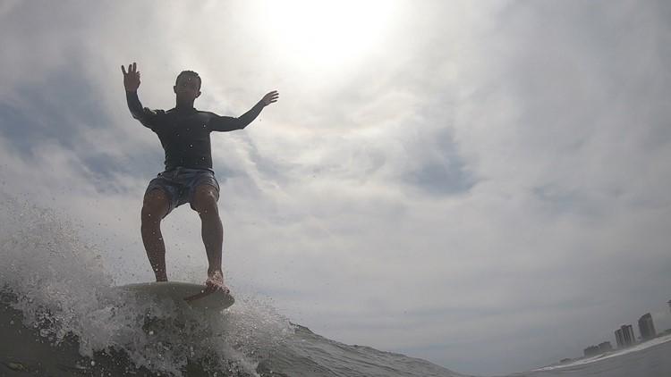 Jon Jon Kaidy hangs five in Jacksonville Beach.