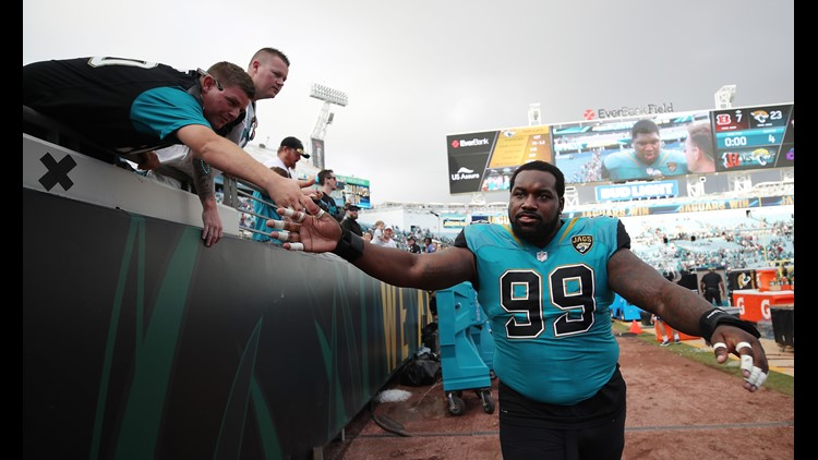 JACKSONVILLE, FL - NOVEMBER 05: Marcell Dareus #99 of the Jacksonville Jaguars greets fans after the Jaguars defeated the Cincinnati Bengals 23-7 at EverBank Field on November 5, 2017 in Jacksonville, Florida. (Photo by Logan Bowles/Getty Images)