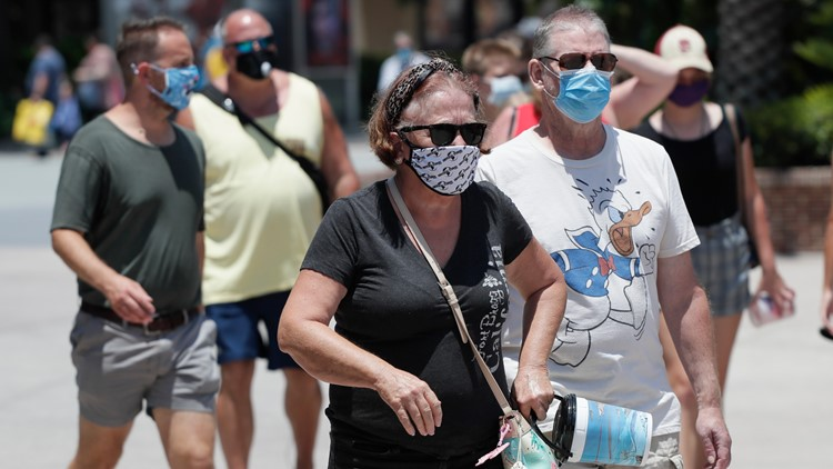 Which Florida theme parks still require masks outdoors?