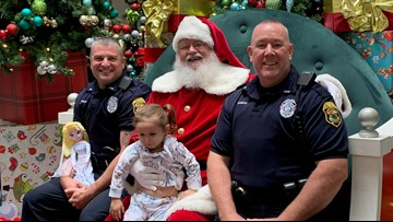 Little girl asks officers to sit on Santa's lap with her