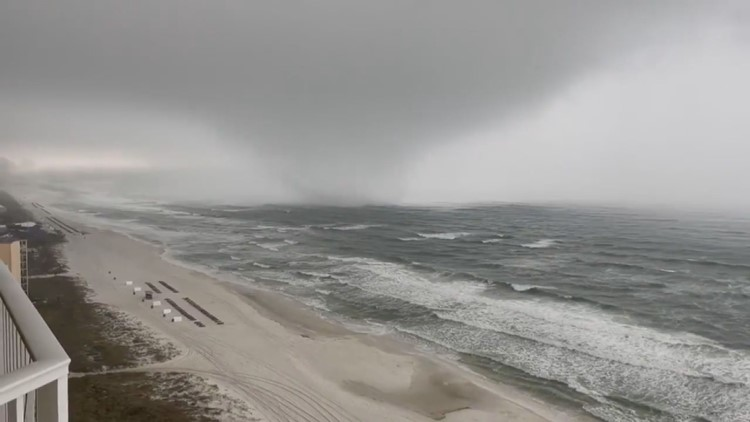 Watch: Large waterspout comes ashore in Panama City Beach
