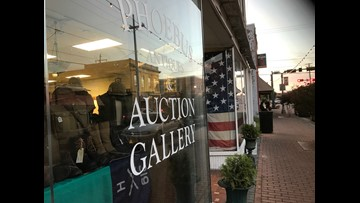 Police: Employee handling gun at auction gallery shoots, kills coworker in Hampton
